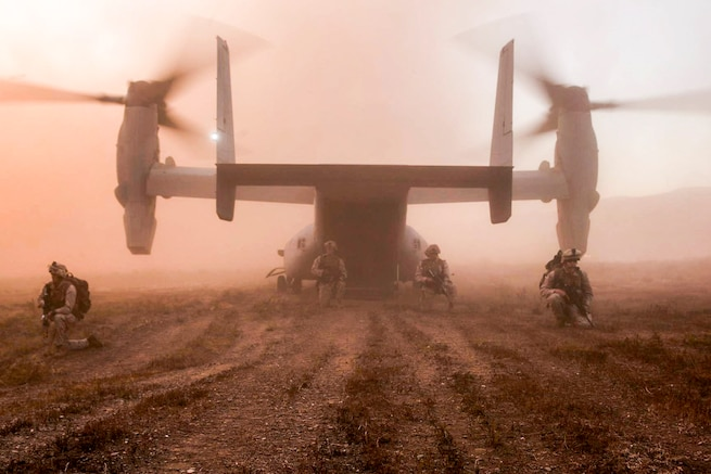 Marines set up security around the back of an MV-22 Osprey during the 11th Marine Expeditionary Unit's composite training unit exercise at Marine Corps Base Camp Pendleton, Calif., Aug. 30, 2016. Marine Corps photo by Lance Cpl. Brandon Maldonado