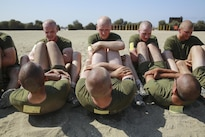 Marine Corps recruits do crunches during a physical fitness test at Marine Corps Recruit Depot San Diego, Aug. 29, 2016. Recruits must run 3 miles in 18 minutes, complete 100 crunches in two minutes and conduct 20 dead hang pullups to get a perfect score. Marine Corps photo by Lance Cpl. Kailey Maraglia