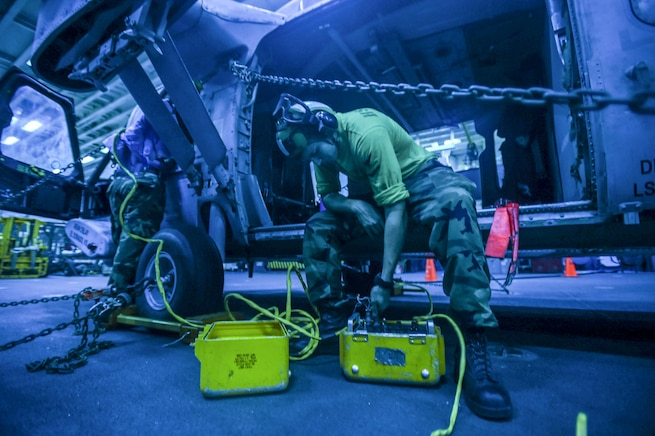 Navy Petty Officer 3rd Class Duke Delay prepares to check an MH-60S Seahawk's automatic blade folding system aboard the USS Bonhomme Richard in the East China Sea, Aug. 28, 2016. The ship is supporting security and stability in the Indo-Asia-Pacific region. Navy photo by Petty Officer 3rd Class Jeanette Mullinax