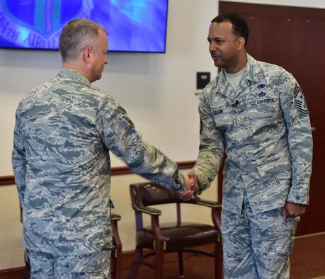 Col. Brian Bowman, commander, 914th Airlift Wing congratulates Chief Master Sgt. Kenneth Eason, command chief, 914 AW during a ceremony at Niagara Falls Air Reserve Station on Aug. 6, 2015. Eason assumes the responsibility of the highest enlisted position in the Wing. (U.S. Air Force photo by Staff Sgt. Richard Mekkri)