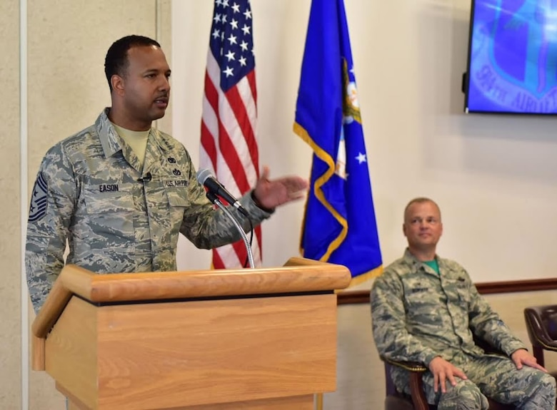 Chief Master Sgt. Kenneth Eason, command chief, 914th Airlift Wing, addresses members of his family and the 914 AW during a ceremony at Niagara Falls Air Reserve Station on Aug. 6, 2015. Eason assumes the responsibility of the highest enlisted position in the Wing. (U.S. Air Force photo by Staff Sgt. Richard Mekkri)