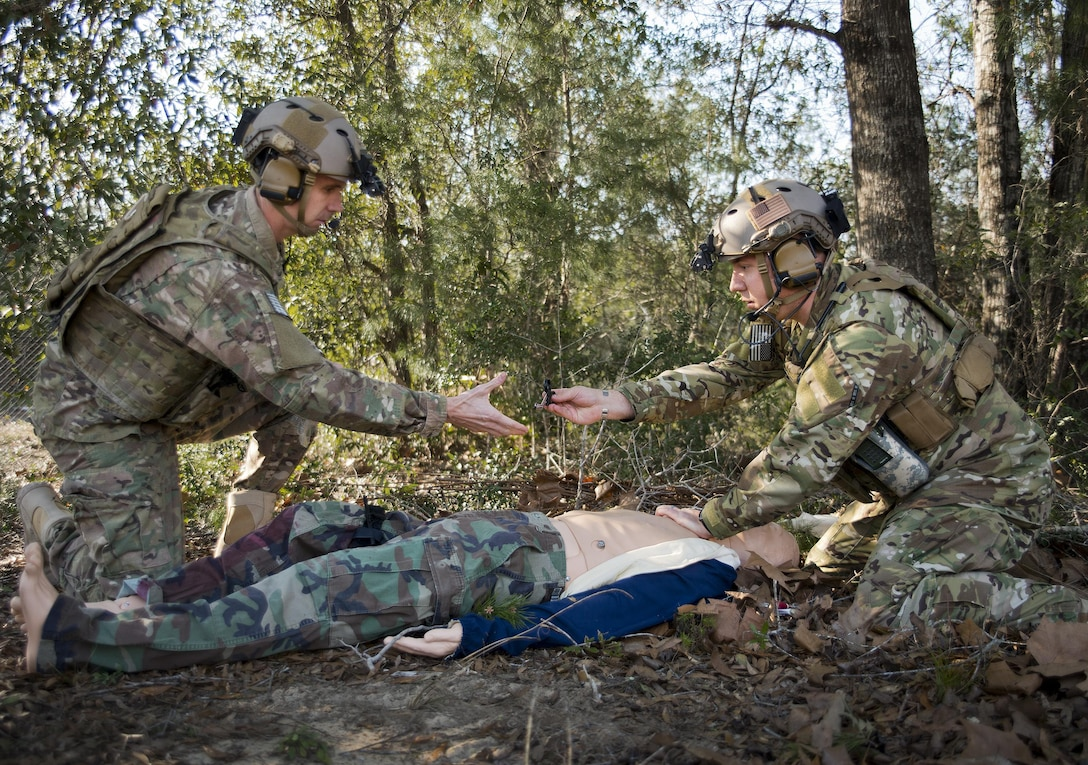 Tech. Sgt. David Mobley and Capt. Chuck Anderson, 711th Special Operations Squadron, perform combat first aid on a simulated victim during a training session at Duke Field, Fla.  The Airmen are combat aviation advisors.  A CAA mission sends a small team of Airmen to assess, advise, train, and assist friendly and allied forces with their own airpower resources.  The training aims to improve the partner nation's air capabilities quickly and show them a way to move forward effectively.  (U.S. Air Force photo/Tech. Sgt. Sam King)