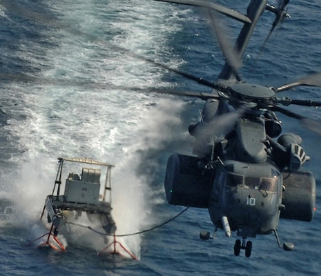The DLA Aviation Customer Operations Directorate's weapons systems program managers, at Richmond, Virginia, strive to keep the H-53 type model series helicopter fleet maintained and up to 100  percent mission ready. The U.S. Navy's MH-53 Sea Dragon is shown performing mine countermeasures using the MK-105 tow sled during operations  while demonstrating the U.S. Navy's ability to defend against mine-laying operations and ensure open access to sea lanes.