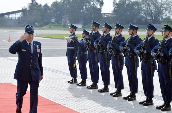 Lt. Gen. Chris Nowland, 12th Air Force (Air Forces Southern) commander, salutes as he's greeted upon arrival in Chile Aug. 19, 2016. The chief of the Chilean Air Force awarded the Chilean Grand Cross of Aeronautical Merit to the general during a visit to Santiago. (Photo courtesy Chilean Air Force)