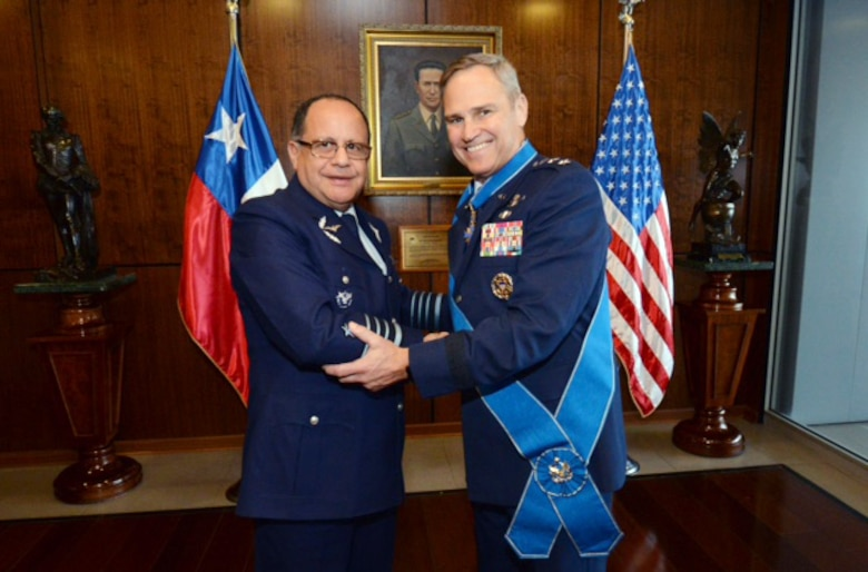 Lt. Gen. Chris Nowland, 12th Air Force (Air Forces Southern) commander (right), poses for a photo with Chief of Staff of the Chilean Air Force, Gen. Jorge Robles Mella after receiving the Chilean Grand Cross of Aeronautical Merit Aug. 19, 2016, in Santiago, Chile. (Photo courtesy Chilean Air Force)