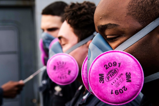 Sailors perform a respirator fit test aboard the USS Green Bay in the Pacific Ocean, Aug. 29, 2016. The amphibious transport dock ship is operating in the U.S. 7th Fleet area of operations to support security and stability in the Indo-Asia-Pacific region. Navy photo by Petty Officer 1st Class Chris Williamson