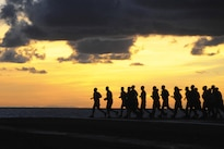 Navy chief petty officers and chief petty officer selectees run across the flight deck aboard the aircraft carrier USS George H.W. Bush in the Atlantic Ocean, Aug. 26, 2016. The aircraft carrier is conducting routine training and qualifications for an upcoming deployment. Navy photo by Seaman Tristan Lotz