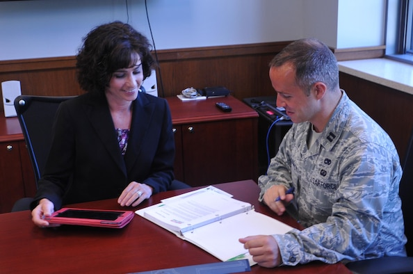 Lynda Rutledge (L), program executive officer and director of the Air Force Life Cycle Management Center's Agile Combat Support Directorate confers with Capt. James Hardwick, executive officer of ACS. (U.S. Air Force photo / Brian Brackens)