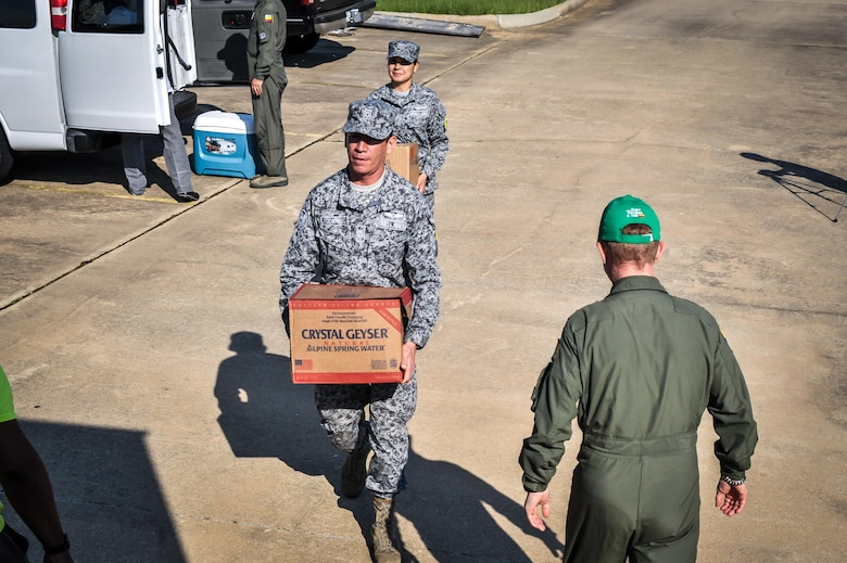 Colombian Airmen haul supplies to an awaiting Salvation Army truck in Bossier City, La., Aug. 27, 2016. Colombian Airmen visiting Barksdale Air Force Base, La., donated supplies to the local Salvation Army for delivery to relief centers in central Louisiana following weeks of torrential rain and flooding in the region. (U.S. Air Force photo / Senior Airman Mozer O. Da Cunha)