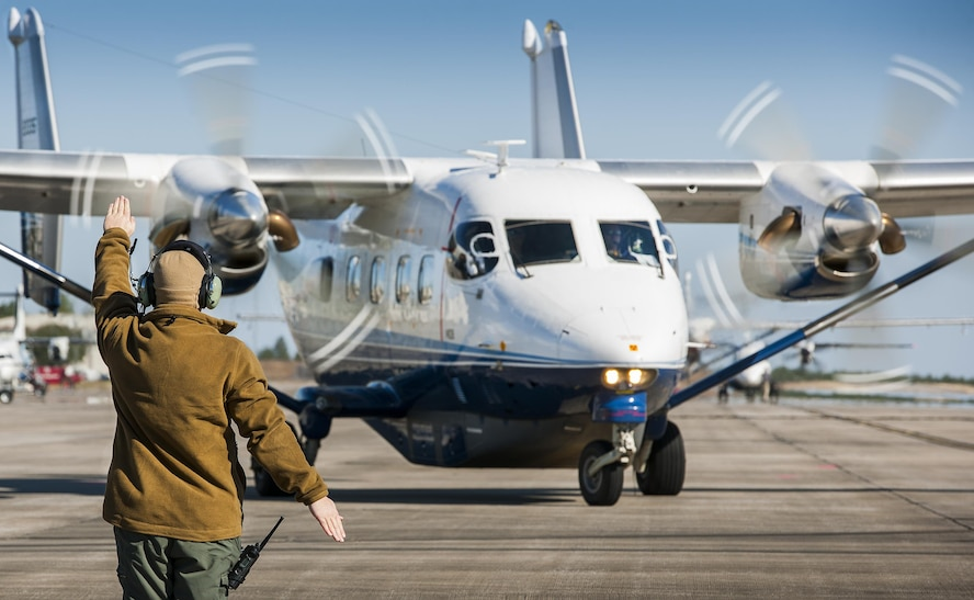 A 919th Special Operations Maintenance Group Airman marshals a C-145A Skytruck toward its mission at Duke Field, Fla.  The Skytrucks are primarily used for new aircrew qualifications and flight proficiency missions.  (U.S. Air Force photo/Tech. Sgt. Sam King)