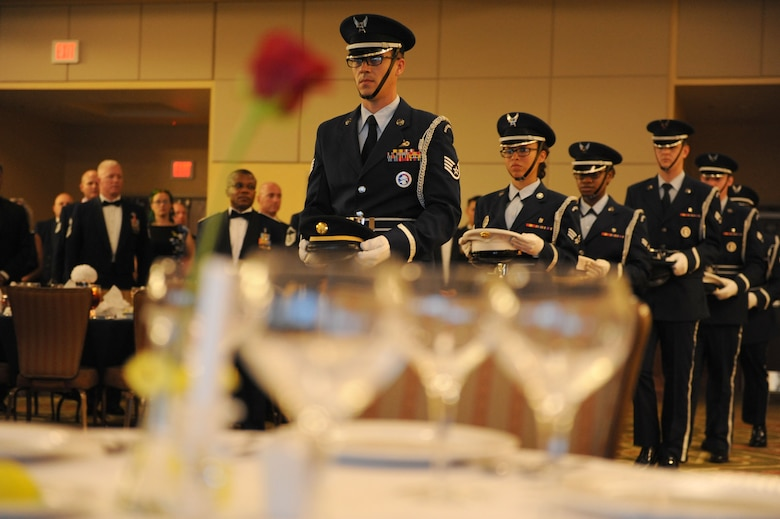 Members of the Keesler Air Force Base Honor Guard perform a POW/MIA table ceremony during the Senior Noncommissioned Officer Induction Ceremony at the Bay Breeze Event Center Aug. 18, 2016, on Keesler Air Force Base, Miss. Thirty-seven enlisted members were recognized and received a commemorative medallion at the event. (U.S. Air Force photo by Kemberly Groue/Released)