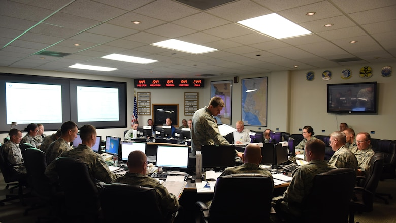 Maj. Matt Hale, 30th Operations Support Squadron operations officer, briefs the Crises Action Team during the recent tabletop exercise, Aug. 22, 2016, Vandenberg Air Force Base, Calif. While a normal base exercise for disaster response can take days, or even weeks, the most recent exercise took place in 90 minutes and only included a small fraction of the base; the CAT, the Emergency Operations Center and the launch team checklists were the primary focus. (U.S. Air Force photo by Senior Airman Ian Dudley/Released)