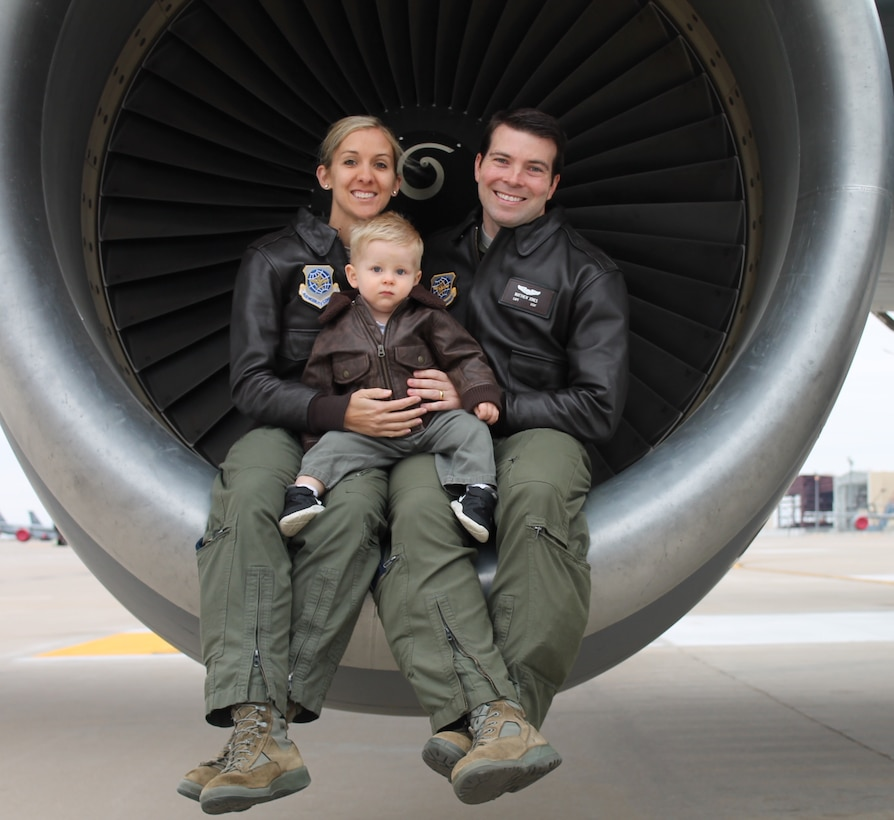 """Capt. Chrystina Jones, left, 350th Air Refueling Squadron pilot, and Maj. Matt Jones, 349th ARS pilot, pose with their son, Dec. 2015, at McConnell Air Force Base, Kan. They both """"refuel the fight"""" as KC-135 Stratotanker pilots, an aircraft that first took flight for the first time 60 years ago. (Courtesy photo)"""