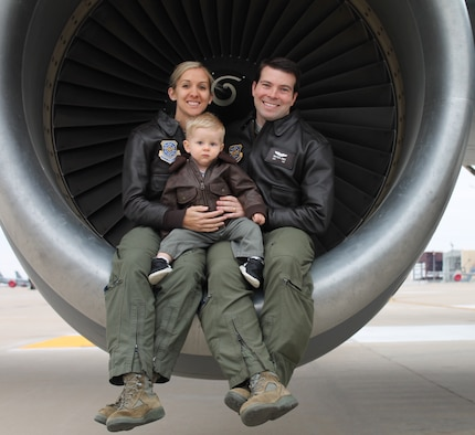 "Capt. Chrystina Jones, left, 350th Air Refueling Squadron pilot, and Maj. Matt Jones, 349th ARS pilot, pose with their son, Dec. 2015, at McConnell Air Force Base, Kan. They both ""refuel the fight"" as KC-135 Stratotanker pilots, an aircraft that first took flight for the first time 60 years ago. (Courtesy photo)"