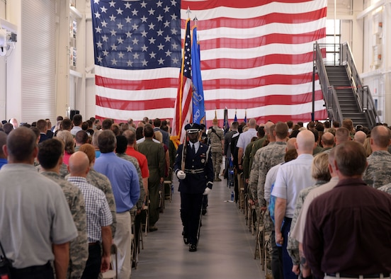 "Members of the Altus Air Force Base Blue Knights Honor Guard, present the colors during the ""Forging the 46"" ceremony, Aug. 30, 2016, at Altus AFB, Okla. The event consisted of an assumption of command for the reactivated 56th Air Refueling Squadron, dedication of the new KC-46 training facility, speeches from key Air Force and community leaders and concluded with a tour of the new facility for attendees. (U.S. Air Force photo by Airman 1st Class Cody Dowell/Released)"
