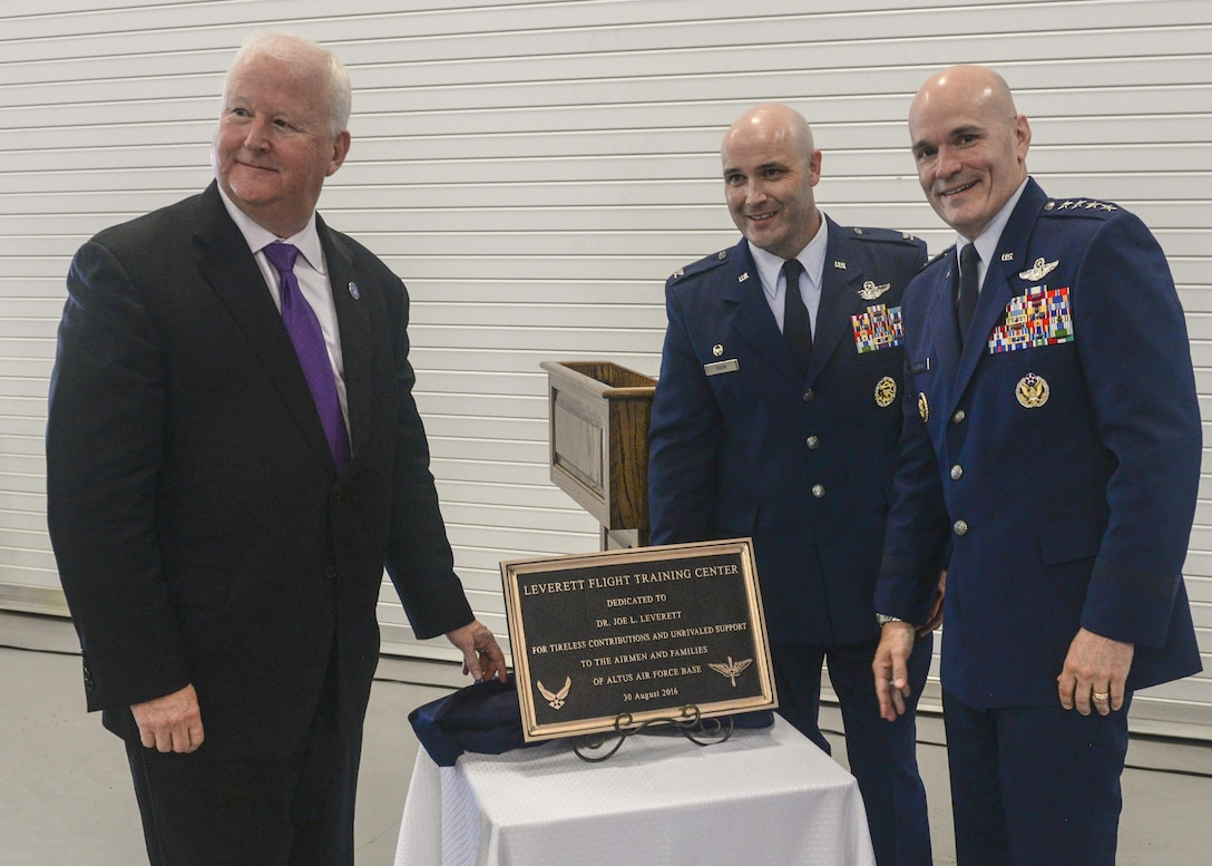 """Dr. Joe Leverett, Chairman of the Altus Military Affairs Committee, along with U.S. Air Force Col. Todd Hohn, commander of the 97th Air Mobility Wing, and U.S. Air Force Gen. Carlton Everhart II, pose for a photo at the """"Forging the 46"""" event, Aug. 30, 2016, at Altus Air Force Base, Okla. The event consisted of an assumption of command for the reactivated 56th Air Refueling Squadron, dedication of the new KC-46 training facility, speeches from key Air Force and community leaders and concluded with a tour of the new facility for attendees.  (U.S. Air Force Photo by Airman Jackson N. Haddon/Released)."""