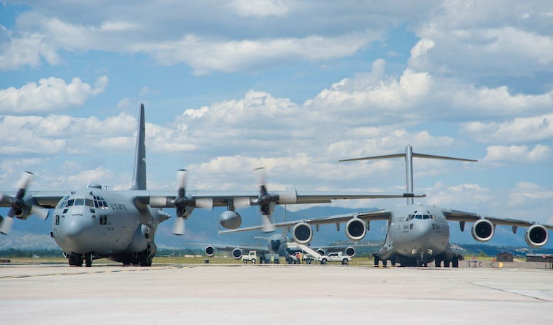 A C-130H3 Hercules, KC-135R Stratotanker and C-17 Globemaster III rest on the Peterson Air Force Base, Colorado, flight line during round robin aeromedical evacuation training missions Saturday, Aug. 28, 2016. More than a dozen 459th AES flight nurses, technicians and administrators flew to Peterson to conduct joint unit training with other AE squadrons onboard the three aircraft. (U.S. Air Force photo/Staff Sgt. Kat Justen)