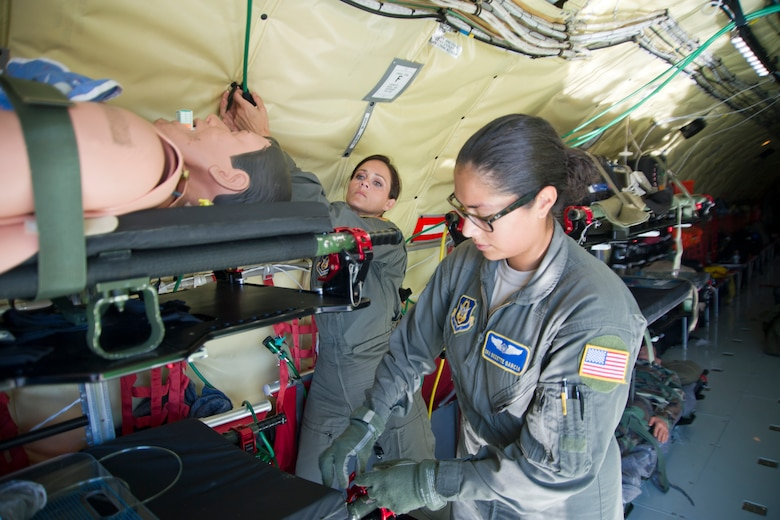 Members of the 459th Aeromedical Evacuation Squadron secure litters and oxygen lines prior to takeoff of a KC-135R Stratotanker on the Peterson Air Force Base, Colorado, flight line, Sunday, Aug. 28, 2016. More than a dozen 459th AES flight nurses, technicians and administrators flew to Peterson to conduct joint unit training with other AE squadrons on board the KC-135, C-17 Globemaster III and C-130H3 Hercules. (U.S. Air Force photo/Staff Sgt. Kat Justen)
