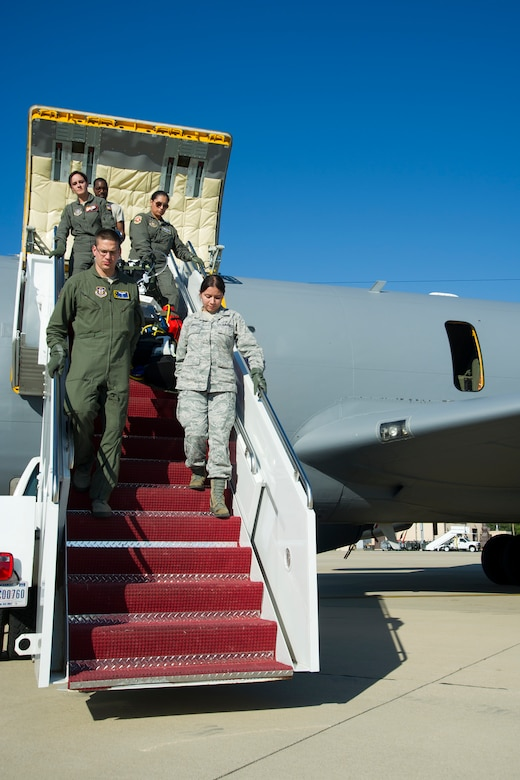 Members of 459th Aeromedical Evacuation Squadron disembark from a KC-135R Stratotanker on the Joint Base Andrews, Maryland, flight line Sunday, Aug. 28, 2016, upon return from joint-unit, multi-aircraft training at Peterson Air Force Base, Colorado. More than a dozen AES flight nurses, technicians and administrators flew to Peterson to conduct joint unit training with other AE squadrons on board the KC-135, C-17 Globemaster III and C-130H3 Hercules. Serving as a medical transport unit, the 459th AES trained for various medical conditions and situations. (U.S. Air Force photo/Staff Sgt. Kat Justen)