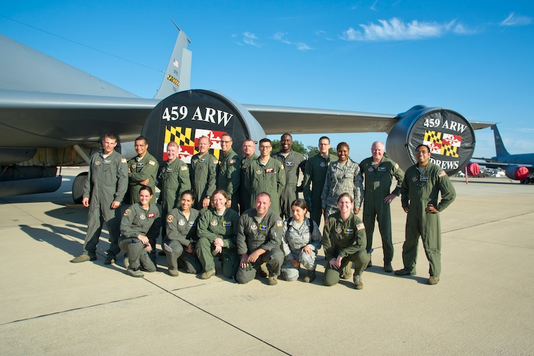 Members of the 459th Aeromedical Evacuation Squadron and 459th Operation Group pose for a group photo on the Joint Base Andrews, Maryland, flight line Sunday, Aug. 28, 2016, upon return from joint-unit, multi-aircraft training at Peterson Air Force Base, Colorado. More than a dozen AES flight nurses, technicians and administrators flew to Peterson to conduct joint unit training with other AE squadrons on board the KC-135R Stratotanker, C-17 Globemaster III and C-130H3 Hercules. Serving as a medical transport unit, the 459th AES trained for various medical conditions and situations. (U.S. Air Force photo/Staff Sgt. Kat Justen)