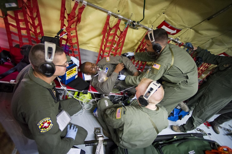 Members of the 459th Aeromedical Evacuation Squadron treat a seizure patient during an exercise onboard a KC-135R Stratotanker enroute from Joint Base Andrews, Maryland, to Peterson Air Force Base, Colorado, Friday, Aug. 26, 2016. More than a dozen AES flight nurses, technicians and administrators flew to Peterson to conduct joint unit training with other AE squadrons on board the KC-135, C-17 Globemaster III and C-130H3 Hercules. Serving as a medical transport unit, the 459th AES trained for various medical conditions and situations. (U.S. Air Force photo/Staff Sgt. Kat Justen)