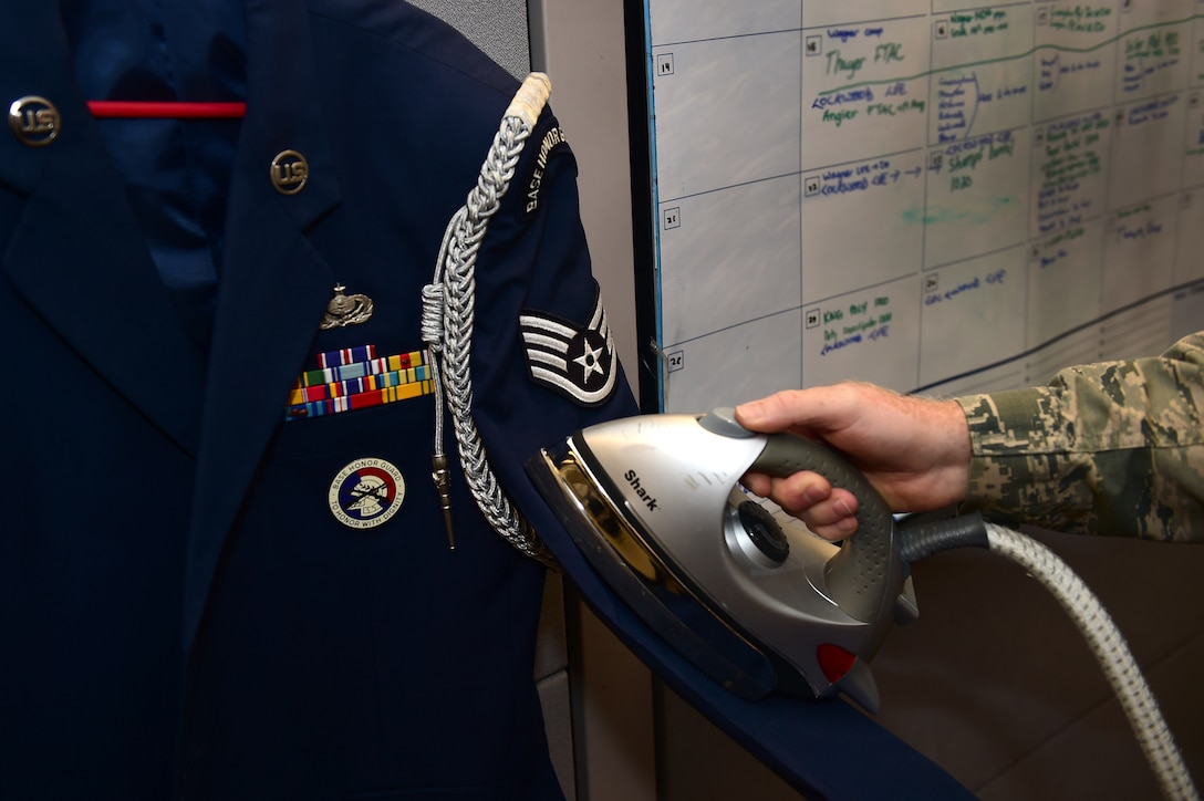 A U.S. Air Force Mile High Honor Guard member steams an honor guard uniform to prepare for a funeral August 30, 2016, on Buckley Air Force Base, Colo. The primary mission of the Honor Guard on Buckley AFB is to provide well-trained, highly professional members to render honors at various military ceremonies. (U.S. Air Force photo by Airman 1st Class Gabrielle Spradling/Released)