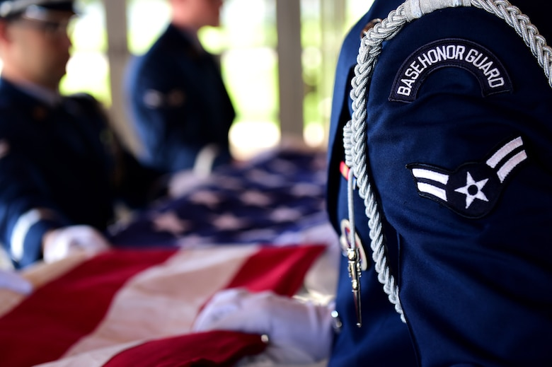 U.S. Air Force Mile High Honor Guard members fold a flag during a funeral August 30, 2016, at Fort Logan National Cemetery, Colo. The Honor Guard represents the Air Force in many ceremonial functions including funerals, changes of command and retirements. (U.S. Air Force photo by Airman 1st Class Gabrielle Spradling/Released)