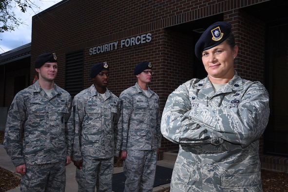 "Lt. Col. Nicole Roberts, 21st Security Forces Squadron commander, relies on a personable leadership style she still uses today to effectively lead her 214 Airmen at Peterson Air Force Base, Colo. Roberts is affectionately known as ""Mama Bear"" around her squadron. (U.S. Air Force photo by Airman 1st Class Dennis Hoffman)"