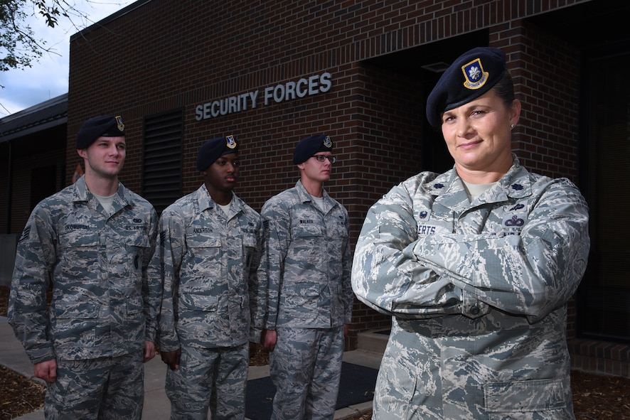 """Lt. Col. Nicole Roberts, 21st Security Forces Squadron commander, relies on a personable leadership style she still uses today to effectively lead her 214 Airmen at Peterson Air Force Base, Colo. Roberts is affectionately known as """"Mama Bear"""" around her squadron. (U.S. Air Force photo by Airman 1st Class Dennis Hoffman)"""