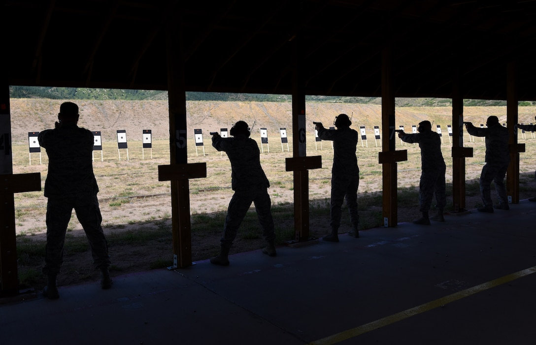 Airmen from the local Colorado area fire down range during the Front Range Competition in Excellence Match at the United States Air Force Academy, Colo., Aug. 22, 2016. Shooters could take part in either the pistol event, using an M9 pistol, or the rifle event, firing an M16A2. (U.S. Air Force photo by Airman 1st Class Dennis Hoffman)