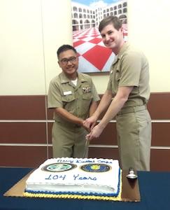 Capt. John Leung (left), senior dental executive, Naval Health Clinic Charleston and Lt. Samuel Joyner, NHCC dentist, cut the cake during a ceremony celebrating the Navy Dental Corps' 104th birthday Aug. 22, 2016 at NHCC's Dental Clinic. (Navy photo by Seaman Kellen Kloss)