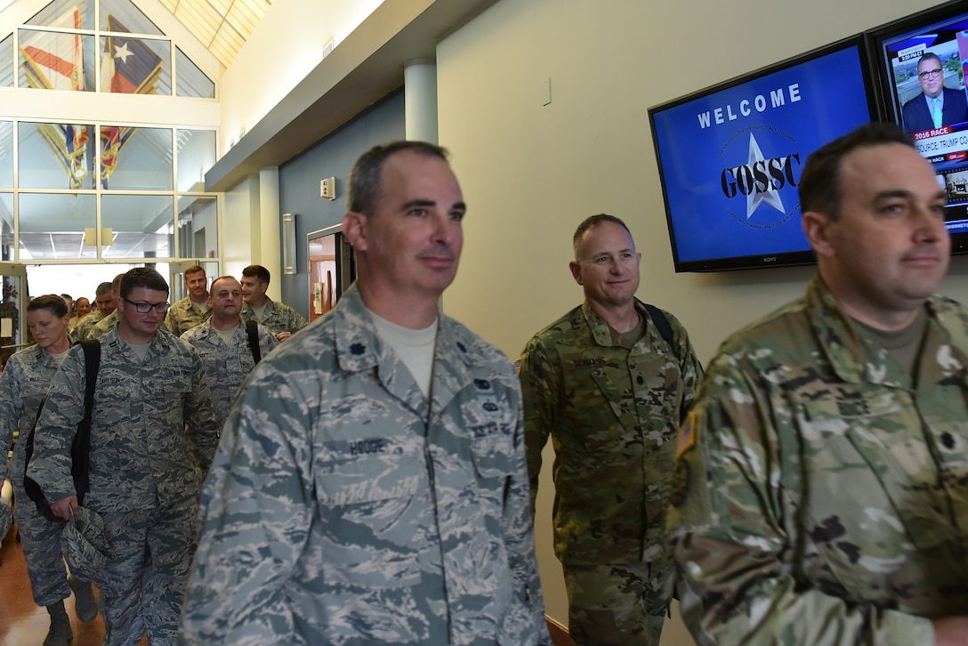 National Guard Soldiers, Airmen and civilians assigned to general officers in the states, territories and the District of Columbia head to networking breakout sessions Aug. 30, 2016, during the General Officer Support Staff Course at the I.G. Brown Training and Education Center on McGhee Tyson Air National Guard Base in Louisville, Tenn. (U.S. Air National Guard photo by Master Sgt. Mike R. Smith)