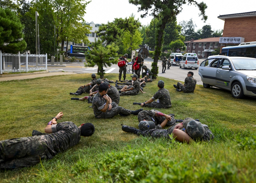 Republic of Korea air force airmen simulate injuries during a joint mass-casualty medical exercise at Osan Air Base, Republic of Korea, Aug. 22, 2016. ROKAF medical personnel worked alongside 51st Medical Group personnel to triage and transport patients to medical facilities while exchanging practices and techniques between the two groups. (U.S. Air Force photo by Senior Airman Victor J. Caputo)