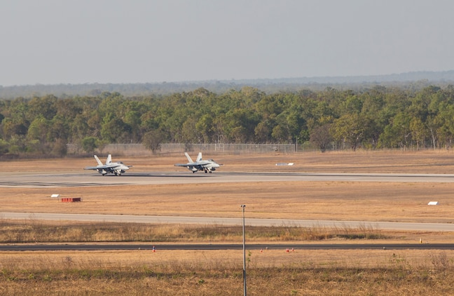 Two F/A-18C Hornets with Marine Fighter Attack Squadron (VMFA) 122 prepare for takeoff during Southern Frontier at Royal Australian Air Force Base Tindal, Australia, Aug. 31, 2016. The Hornet squadron performed low-altitude tactics training throughout the last week of training, allowing the pilots to gain confidence in low flying and simultaneously conducting air-to-surface maneuvers. Southern Frontier is a three week unit level training helping pilots gain experience and qualifications in low-altitude tactics, close air support, and air ground, high explosive ordnance delivery. (U.S. Marine Corps photo by Cpl. Nicole Zurbrugg)