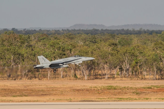 An F/A-18C Hornet with Marine Fighter Attack Squadron (VMFA) 122 takes off during Southern Frontier at Royal Australian Air Force Base Tindal, Australia, Aug. 31, 2016. VMFA-122 executed low-altitude tactics training, flying below 500 feet to evade simulated enemy radar detection or to escape enemy aircraft vectored toward friendly aircraft. By integrating low-altitude tactics into the three week unit level training, pilots gained their final qualifications during Southern Frontier, strengthening the squadrons overall combat readiness. (U.S. Marine Corps photo by Cpl. Nicole Zurbrugg)