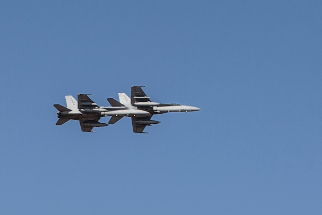 Two F/A-18C Hornets with Marine Fighter Attack Squadron (VMFA) 122 fly over head during Southern Frontier at Royal Australian Air Force Base Tindal, Australia, Aug. 31, 2016. The Hornet squadron trained in low-altitude tactics, building pilots' confidence and skills with low flying while performing air-to-surface maneuvers simultaneously. Southern Frontier is a three week unit level training helping pilots gain experience and qualifications in low-altitude tactics, close air support, and air ground, high explosive ordnance delivery. (U.S. Marine Corps photo by Cpl. Nicole Zurbrugg)