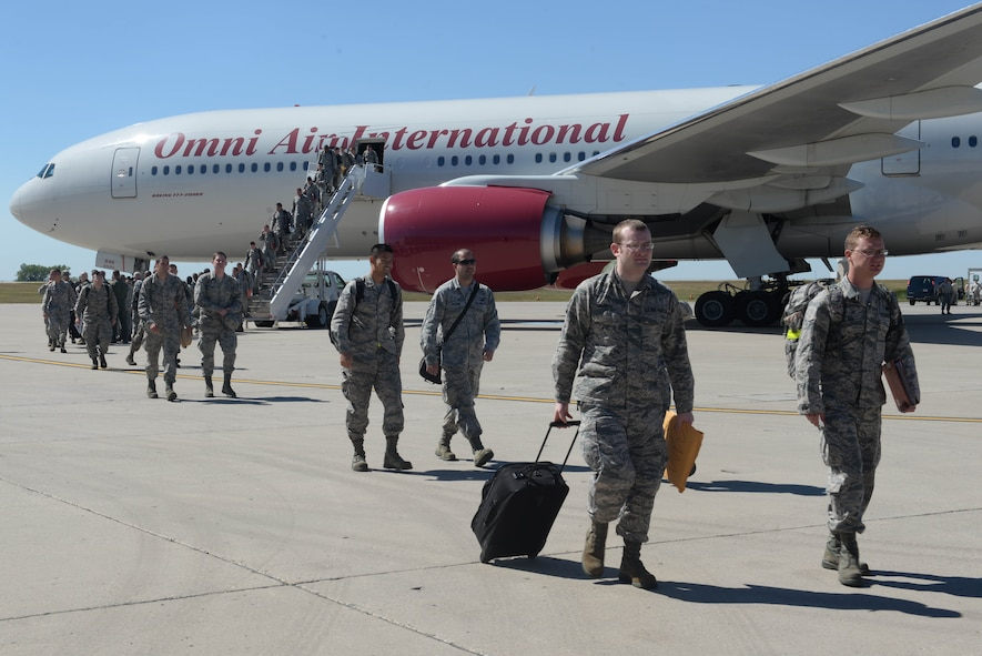 Airmen return home from a six-month deployment at Minot Air Force Base, N.D., Aug. 29, 2016. Airmen will soon undergo reintegration to ease back into their work and family life. (U.S. Air Force Photo/Airman 1st Class Jessica Weissman)