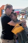 Senior Airman Rebecca Gibson, an Airman assigned to the 5th Munitions Squadron, embraces her husband at Minot Air Force Base, N.D., Aug. 29, 2016. Various Minot AFB Airmen were deployed to Andersen AFB, Guam, in support of the continuous bomber presence. (U.S. Air Force Photo/Airman 1st Class Jessica Weissman)