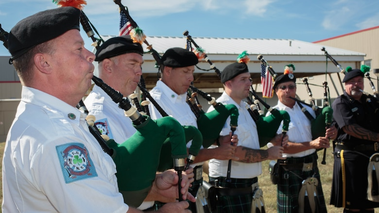Members of the New York Police Department Emerald Society perform the Marines' Hymn during a remembrance ceremony for two Reserve Marines from Brooklyn's 6th Communication Battalion at Floyd Bennett Field, Aug. 30, 2016. Sgt. Maj. Michael S. Curtin and Gunnery Sgt. Matthew D. Garvey, first responders with the city's police fire departments, lost their lives at the World Trade Center on 9/11. To honor their memory, Marine Corps Reserve Center Brooklyn dedicated the Curtin Garvey Complex and a 9/11 monument made partially with steel from the World Trade Center. The remembrance ceremony is being held in conjunction with the U.S. Marine Corps Reserve Centennial, celebrating 100 years of service and selfless dedication to the nation.
