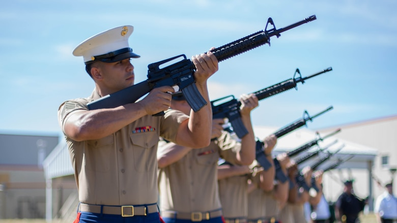 A rifle detail from Brooklyn's 6th Communication Battalion fire three rifle volleys during a remembrance ceremony for two Reserve Marines from their unit at Floyd Bennett Field, Aug. 30, 2016. Sgt. Maj. Michael S. Curtin and Gunnery Sgt. Matthew D. Garvey, first responders with the city's police fire departments, lost their lives at the World Trade Center on 9/11. To honor their memory, Marine Corps Reserve Center Brooklyn dedicated the Curtin Garvey Complex and a 9/11 monument made partially with steel from the World Trade Center. The remembrance ceremony is being held in conjunction with the U.S. Marine Corps Reserve Centennial, celebrating 100 years of service and selfless dedication to the nation.