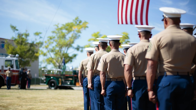 Marines from Brooklyn's 6th Communication Battalion stand at attention during a remembrance ceremony for two Reserve Marines from their unit at Floyd Bennett Field, Aug. 30, 2016. Sgt. Maj. Michael S. Curtin and Gunnery Sgt. Matthew D. Garvey, first responders with the city's police fire departments, lost their lives at the World Trade Center on 9/11. To honor their memory, Marine Corps Reserve Center Brooklyn dedicated the Curtin Garvey Complex and a 9/11 monument made partially with steel from the World Trade Center. The remembrance ceremony is being held in conjunction with the U.S. Marine Corps Reserve Centennial, celebrating 100 years of service and selfless dedication to the nation.