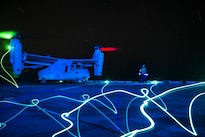 A Marine Corps MV-22 Osprey aircraft prepares for takeoff from the flight deck of the amphibious assault ship USS Boxer in the Pacific Ocean, Aug. 26, 2016. Navy photo by Petty Officer 3rd Class Michael T. Eckelbecker