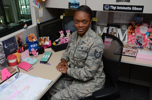 Air Force Tech. Sgt. Antoinette Gibson is surrounded by photos and other items that remind her of her two daughters in her cubicle Aug. 24, 2016, at the Defense Information School on Fort Meade. Gibson, an instructor in the Basic Photojournalist Course-USAF, was selected as the school's Warrior of the Quarter for the second quarter of 2016.