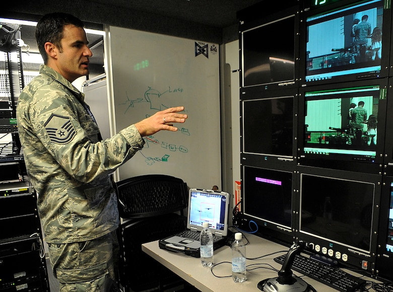 Master Sgt. John Zelinski, Polygone Electronic Warfare Training Range Live, Virtual, Constructive program manager, explains the capabilities of the Multinational Aircrew Electronic Warfare Training Facility Live Virtual Constructive Training System (MALTS) during an open house Aug. 25, 2016, at Einsiedlerhof Air Station, Germany. As a detachment of the Warrior Preparation Center, Polygone uses MALTS to deliver world-class Integrated Air Defense System simulation anywhere in the world. (U.S. Air Force photo/Senior Airman Larissa Greatwood)
