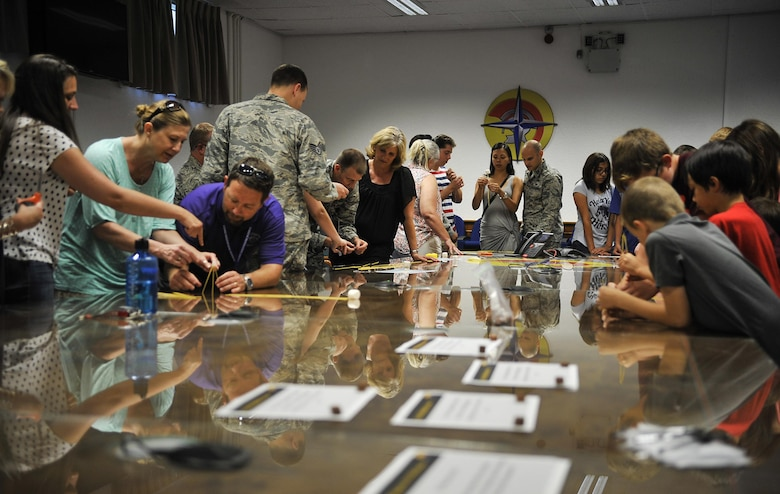 Warrior Preparation Center Airmen and their families participate in a game to see who can build the tallest free-standing structure out of spaghetti noodles and marshmallows during an open house Aug. 25, 2016, at Einsiedlerhof Air Station, Germany. The activity demonstrated the importance of pre-planning, which is applied in the WPC mission. (U.S Air Force photo/Senior Airman Larissa Greatwood)