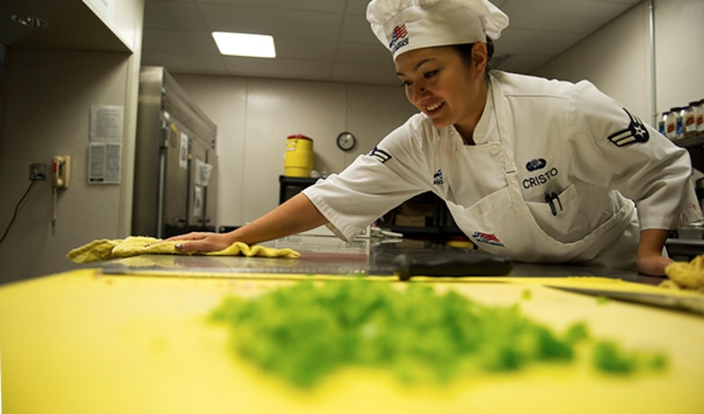 Airman 1st Class Tiffany Cristo, 92nd Force Support Squadron food services apprentice, cleans the flight kitchen Aug. 30, 2016, at Fairchild Air Force Base. The supplemental options in the boxed meals are often pre-contained food items such as individual packages of raisins and granola bars. For the entrées, the kitchen makes several different types of sandwiches including turkey, ham and peanut butter and jelly. (U.S. Air Force photo/Airman 1st Class Sean Campbell)