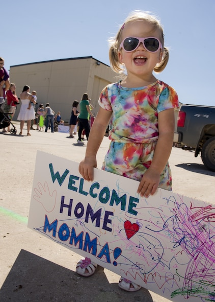 A child awaits her mother's return at Dock 9 at Minot Air Force Base, N.D., Aug. 29, 2016. The 69th Bomb Squadron returned home after a six-month deployment to Andersen Air Force Base, Guam. (U.S. Air Force photo/Airman 1st Class J.T. Armstrong)