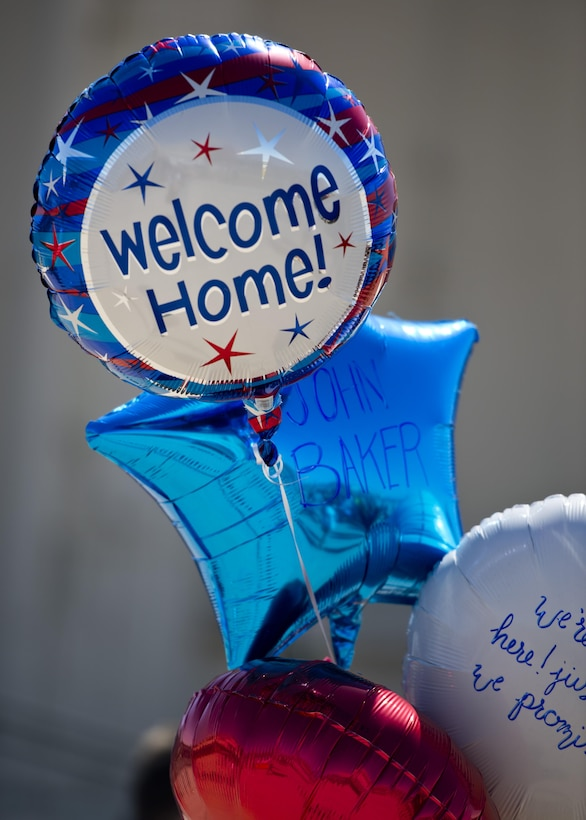 Balloons are held by family members of a deployed Airman at Minot Air Force Base, N.D., Aug. 29, 2016. Family members awaited the 69th Bomb Squadron's return home after a six-month deployment to Andersen Air Force Base, Guam. (U.S. Air Force photo/Airman 1st Class J.T. Armstrong)