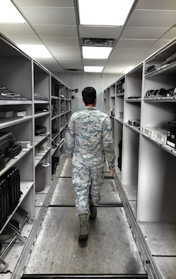 Senior Airman Josh Lemley, 507th Aircraft Maintenance Squadron locates equipment to assist with KC-135 maintenance on Aug. 10, 2016 at Tinker Air Force Base, Oklahoma. (U.S. Air Force Photo/Staff Sgt. Brian Abion)