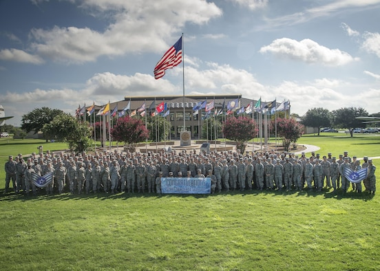 Joint Base San Antonio-Lackland staff sergeant selectees gather for a group photo after being notified of their selection Aug. 25, 2016 at JBSA-Lackland. Out of 39,064 eligible senior airmen, 16,506 were selected for promotion with a selection rate of 42.25 percent.